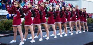 The University of Indianapolis cheerleading squad lines up and places their hands over their hearts during the national anthem at a UIndy football game. Photo by Zefeng Zhang