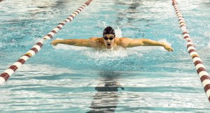 Senior Justin Rossillo comes up for a breath in the middle of a race while doing the butterfly stroke. Photos contributed by Laken Detweiler
