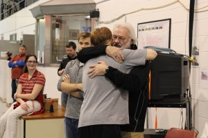 Former Head Swimming and Diving Coach Gary Kinkead embraces senior Aaron Stevenson during the Greyhounds' Senior Day on Jan. 24 at the Ruth Lilly Fitness Center. Photo contributed by UIndy Sports Information