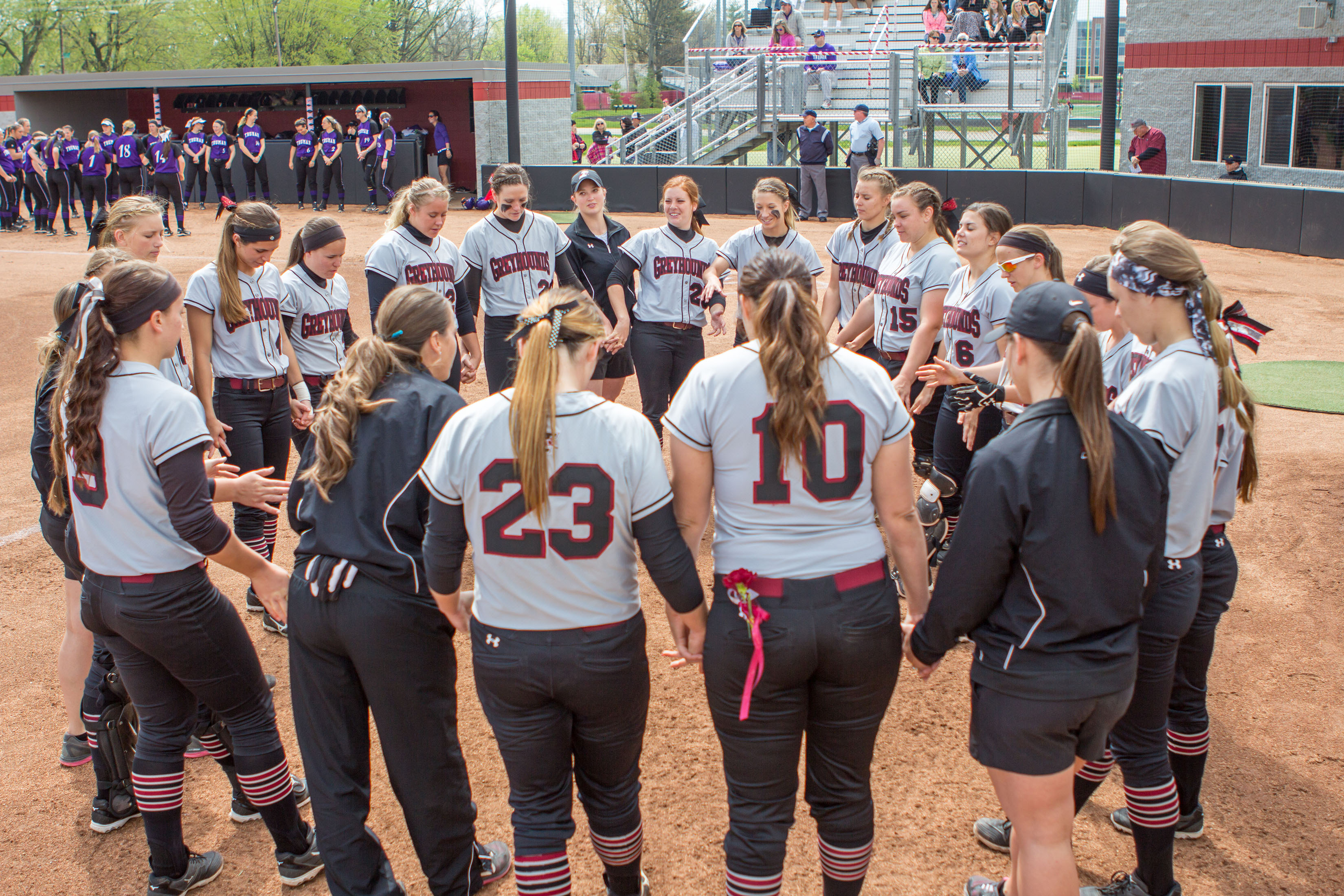The Greyhounds circled up before the start of the game against Truman State University on Saturday, April 23. UIndy honored its seniors prior to the start of the game. The Hounds beat the Bulldogs 5-1 and 3-2. Photo by Kameron Casey