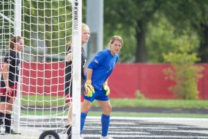 With senior Emma Crenshaw in goal, the Greyhounds fell 2-1 against Rockhurst University on Sept. 18. Crenshaw made 12 saves against the Hawks. Photo by Jennifer Ulrey.