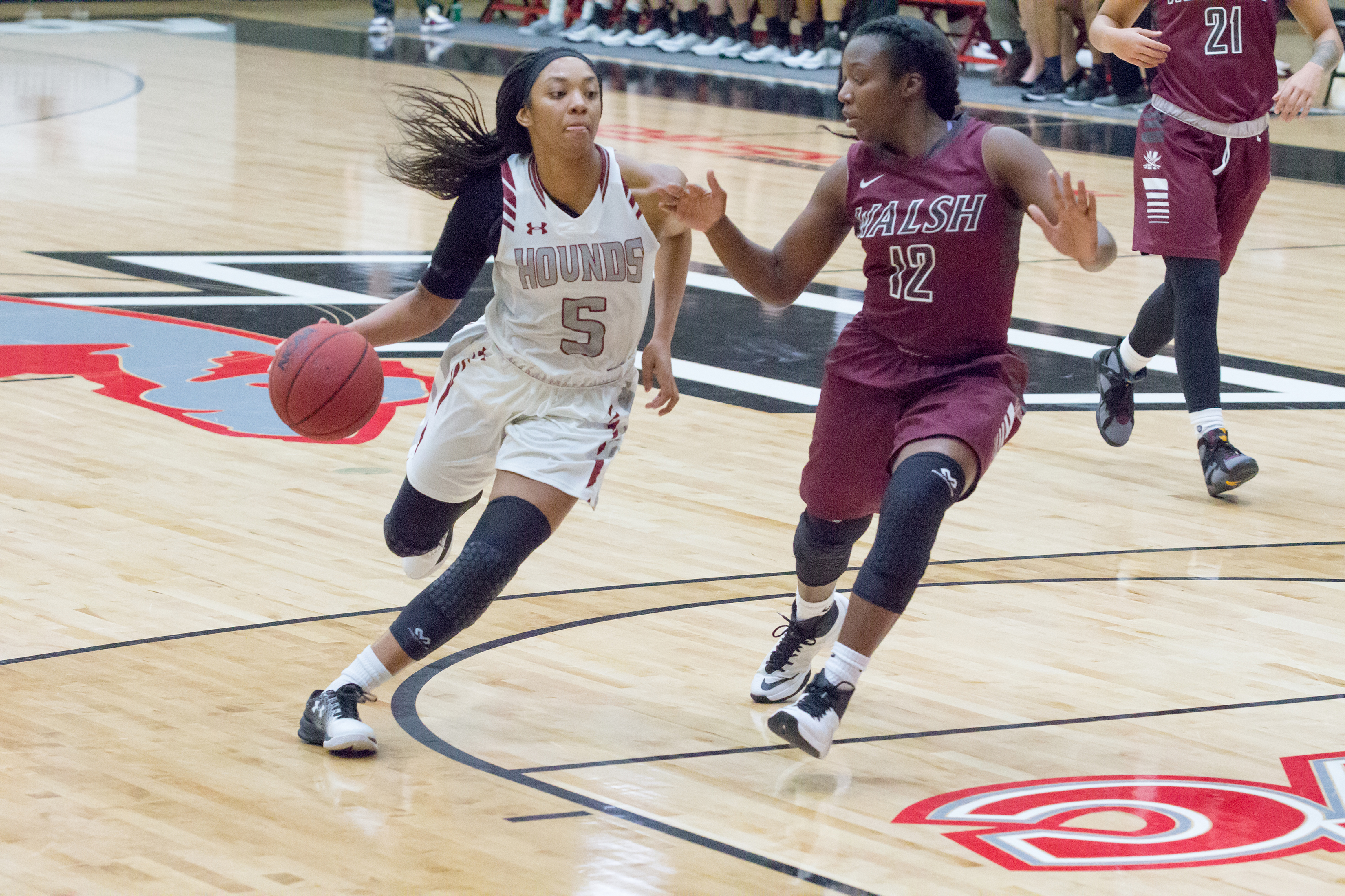 Junior guard Devin Ferguson drives up the court in a game against Walsh University on Nov. 13. The game was a part of the GLIAC/GLVC Challenge hosted by UIndy. Photo by Jennifer Ulery