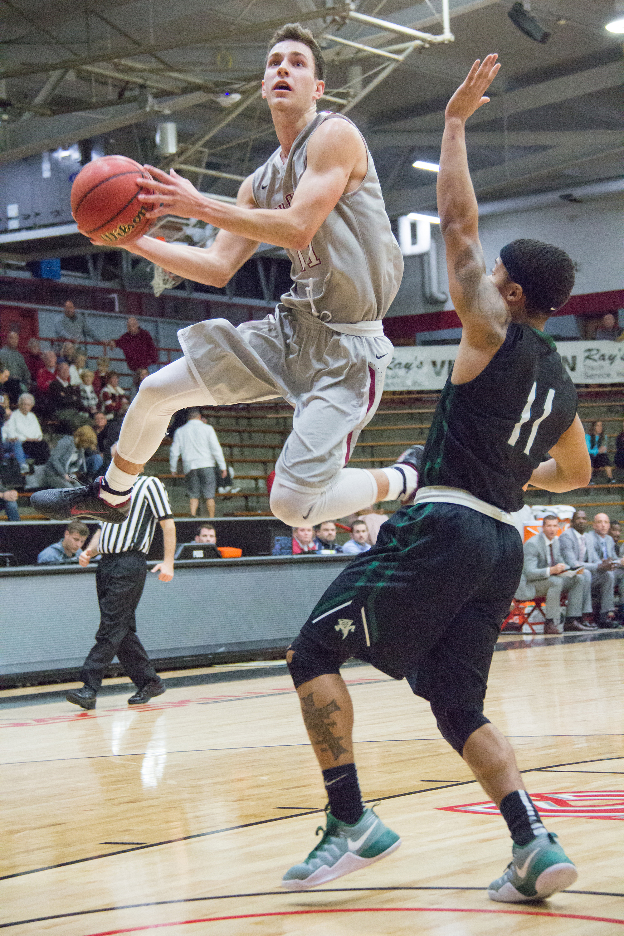 Sophomore guard Jimmy King takes a layup in the game against Lake Erie College on Nov. 13 in the GLIAC/GLVC Challenge, which was hosted by UIndy in Nicoson Hall. Photo by Jennifer Ulery