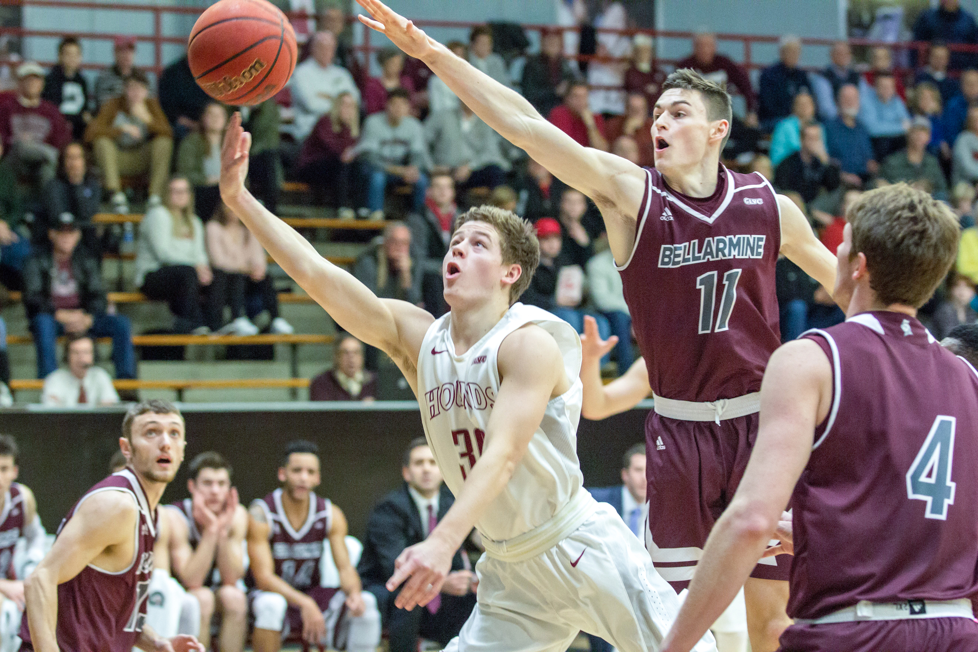 Junior Eric Davidson attempts to add two points on the board while fighting through two Bellarmine defenders.