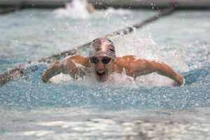 Junior David Salmon competes in the 400 medley relay. Photo by Cassie Reverman