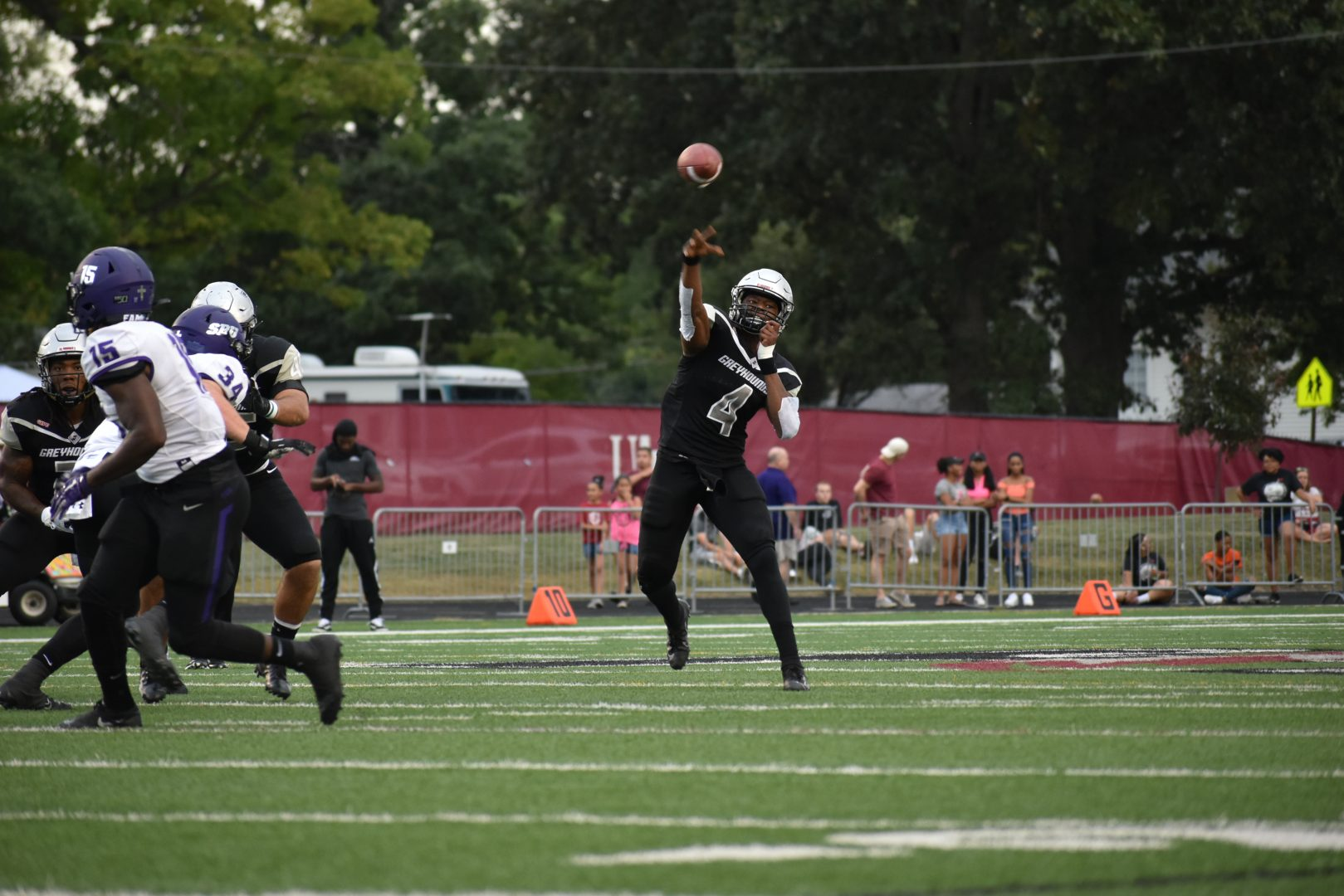 In this file photo, senior quarterback TJ Edwards throws the ball upfield during a home game against the Truman University Bulldogs on Nov. 9, 2019.