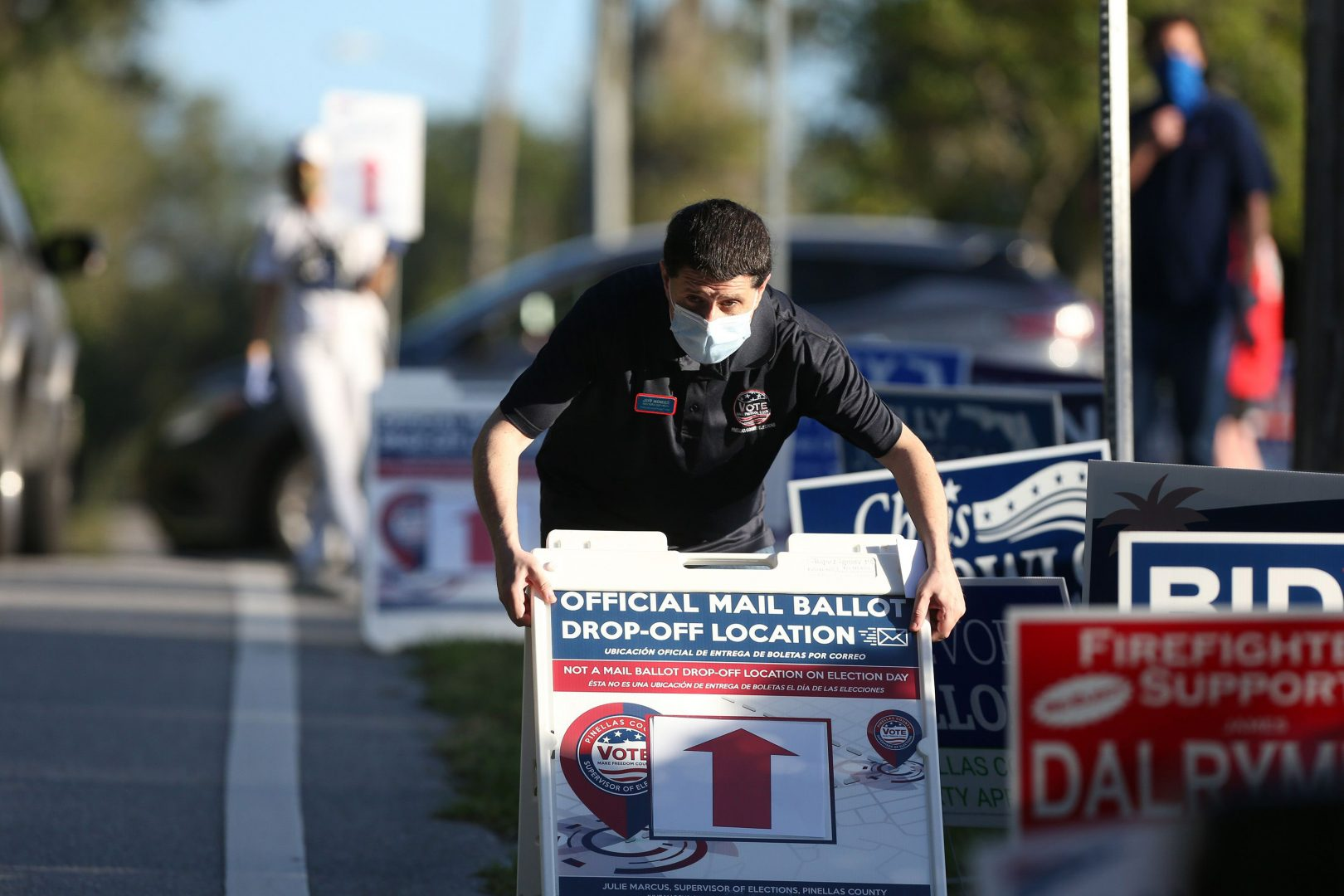 Jeff Mendes, an elections deputy with the Pinellas County Supervisor of Elections, displays a sign to inform voters of a mail ballot drop-off location at The Centre of Palm Harbor.
