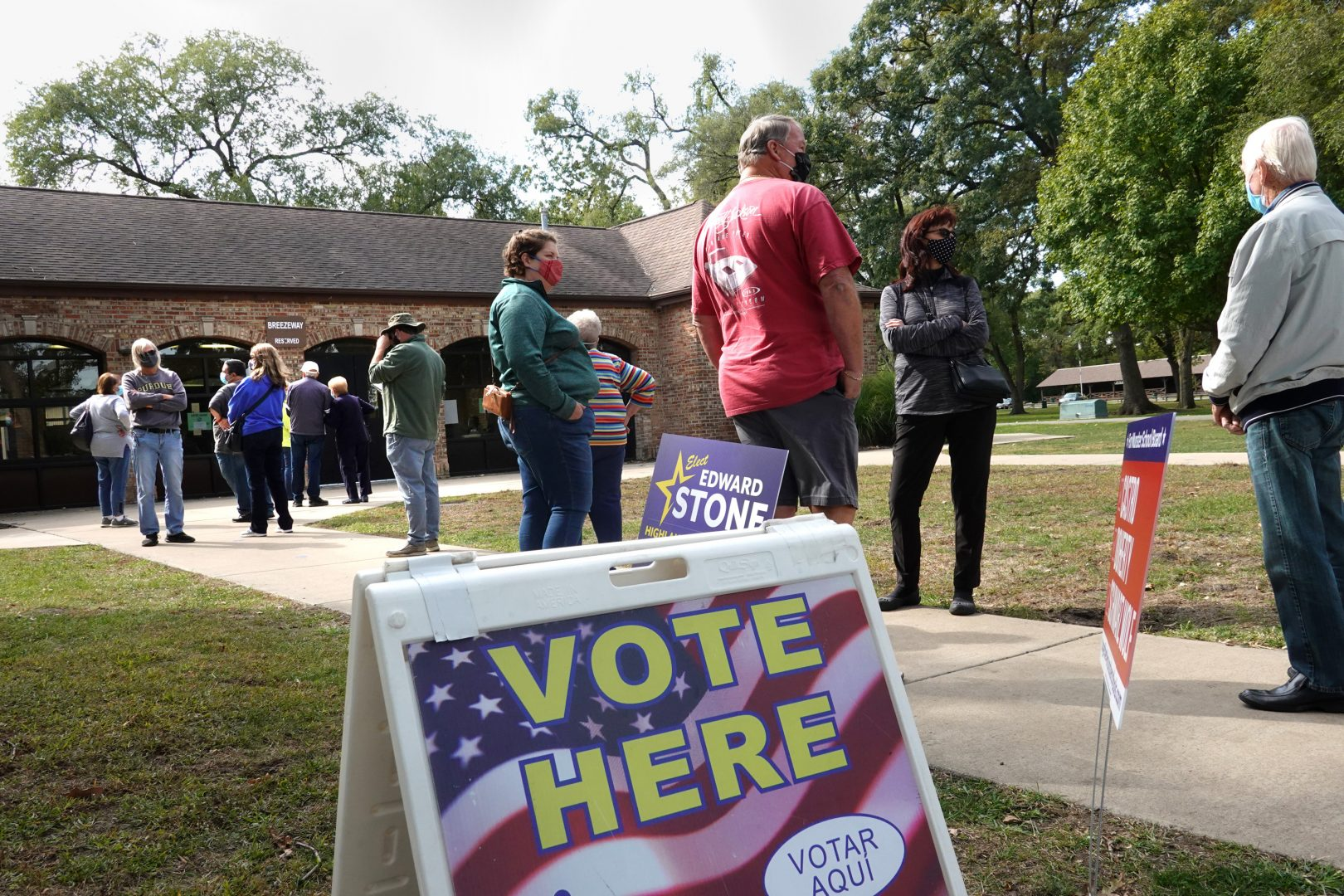 Residents wait in line to vote at the Wicker Park Social Center on October 06, 2020 in Highland, Indiana