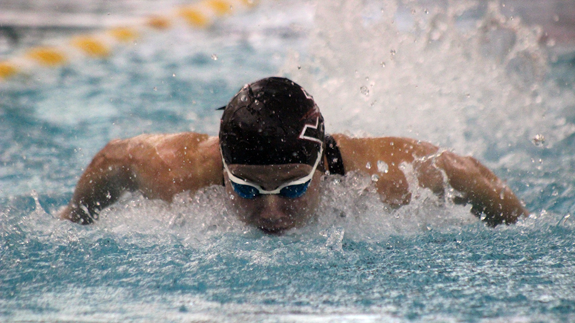 Junior swimmer Johanna Buys performs the butterfly stroke during the UIndy Intersquad meet on Oct. 17. In the meet, the Hounds were divided into Crimson and Grey, with Crimson winning the meet with a score of 692-664. Buys won the 100 free in 53.26 seconds
