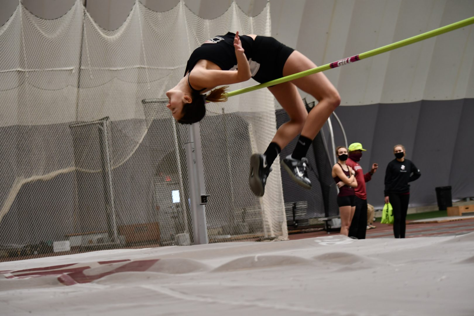 Senior jumper Taylor Strnad attempts a high jump of 1.70 meters which is a try at the UIndy women's high jump indoor school record. Strnad won the event for the Greyhound invite with a jump of 1.65 meters. Senior jumper Chandler Martin got second with a 1.85m jump.